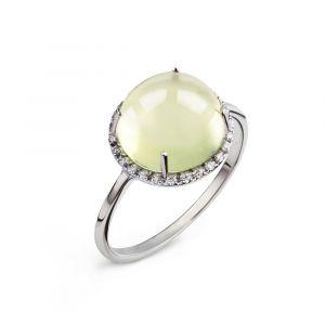 Une bague lemon quartz cabochon et diamants